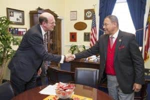 U.S. Representative Sanford Bishop of Georgia right meets with Jonathan Reckford