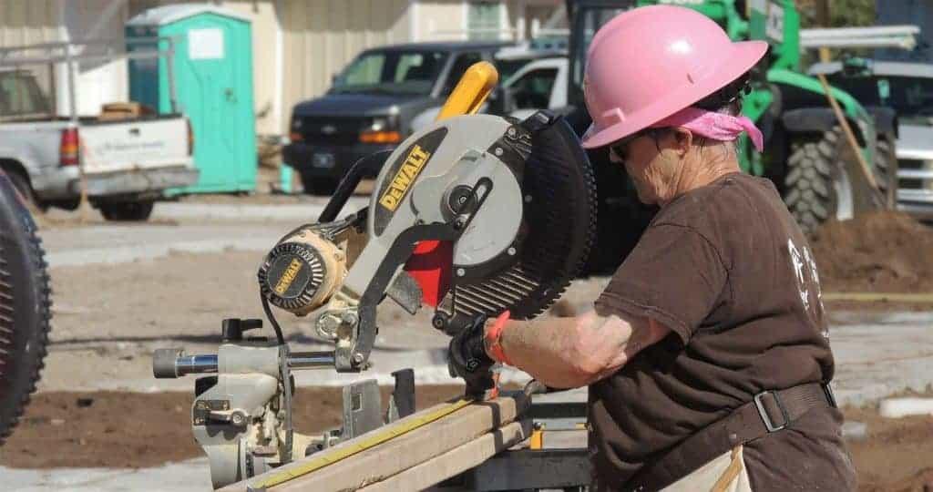 Woman using skill saw