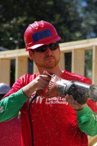Staff member Chris using a reciprocating saw