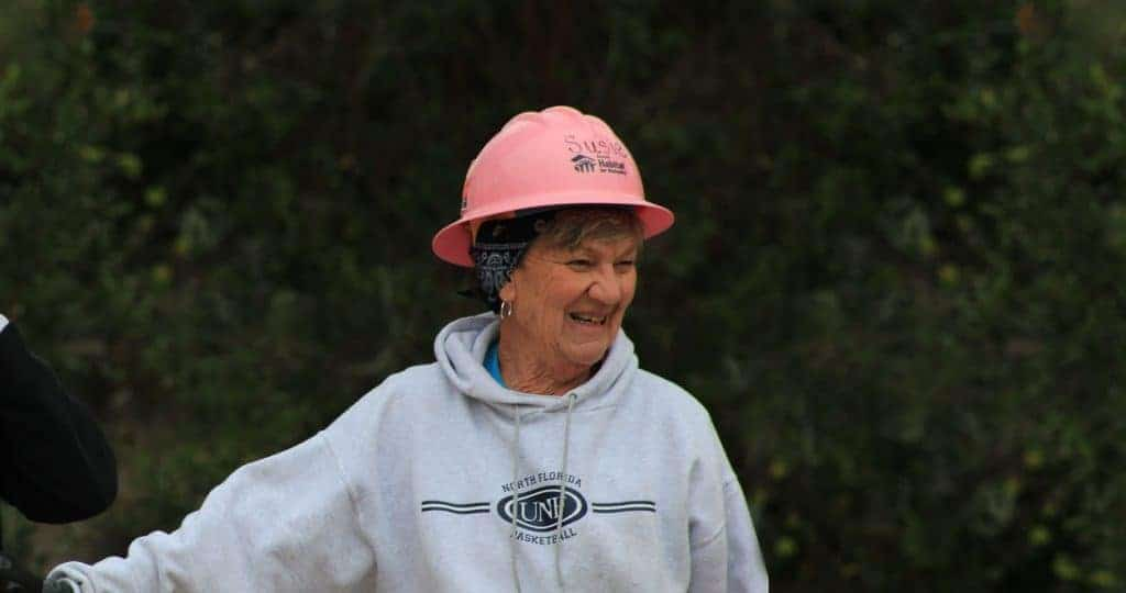 Woman in pink hard hat on site