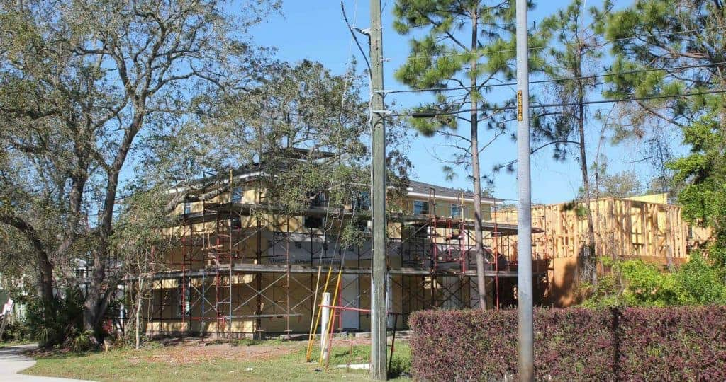 View of homes under construction from front entrance of neighborhood