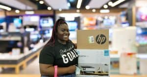 Young woman in electronics store