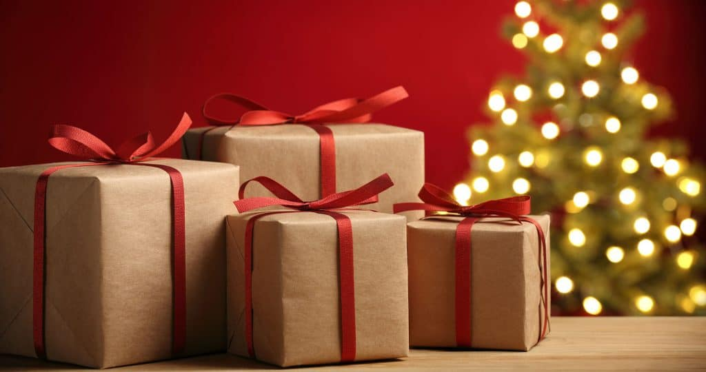 Christmas Gifts Wrapped in brown paper with red ribbons