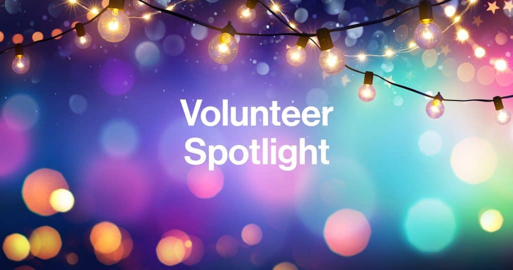 Volunteer Spotlight over Colorful Lights