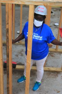 Beaches Habitat future homeowner, Charlene standing inside her home that is currently under construction.