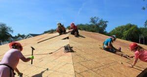 Women Build volunteers nailing on roof