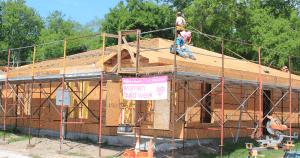 Home under construction with Women Build Week banner